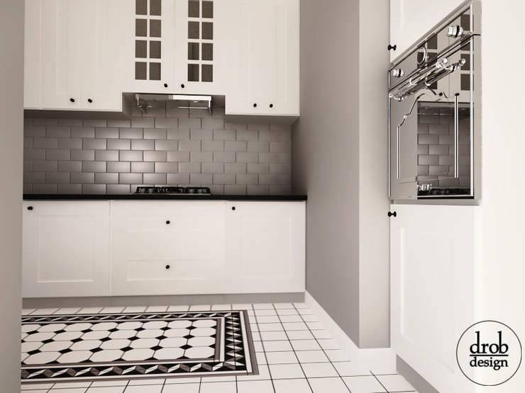 Kuchnia w stylu klasycznym - mieszkanie w Lublinie. Widok od strony Salonu: styl , w kategorii Kuchnia zaprojektowany przez Drob Design ,Klasyczny Ceramiczny