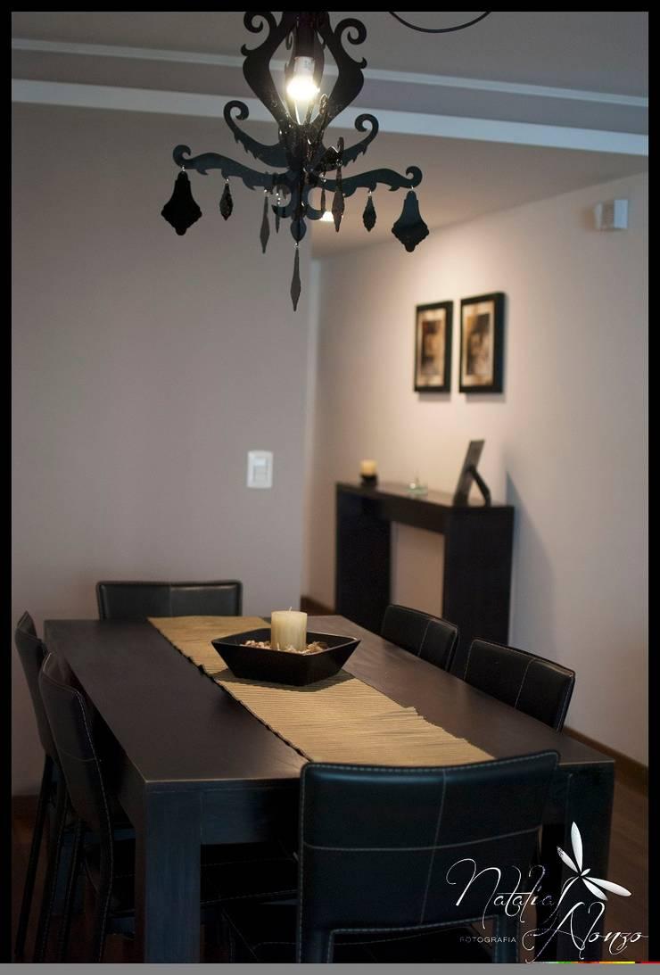Departamento Punta Carretas: Comedores de estilo  por Diseñadora Lucia Casanova