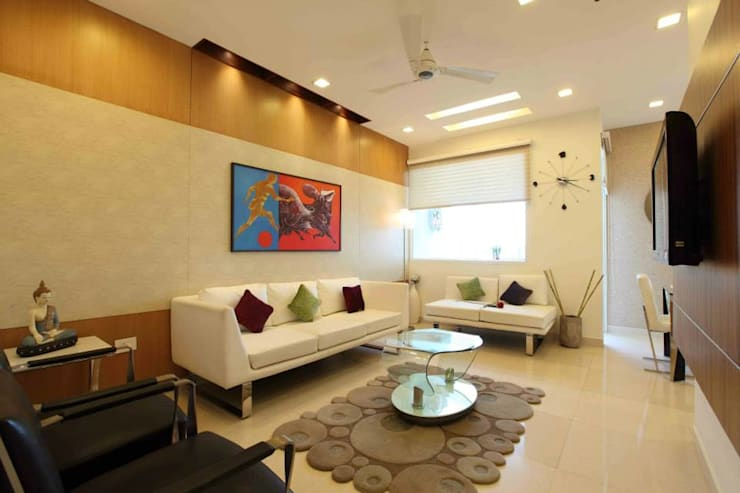 SAMPLE FLAT:  Living room by Spaces Architects@ka