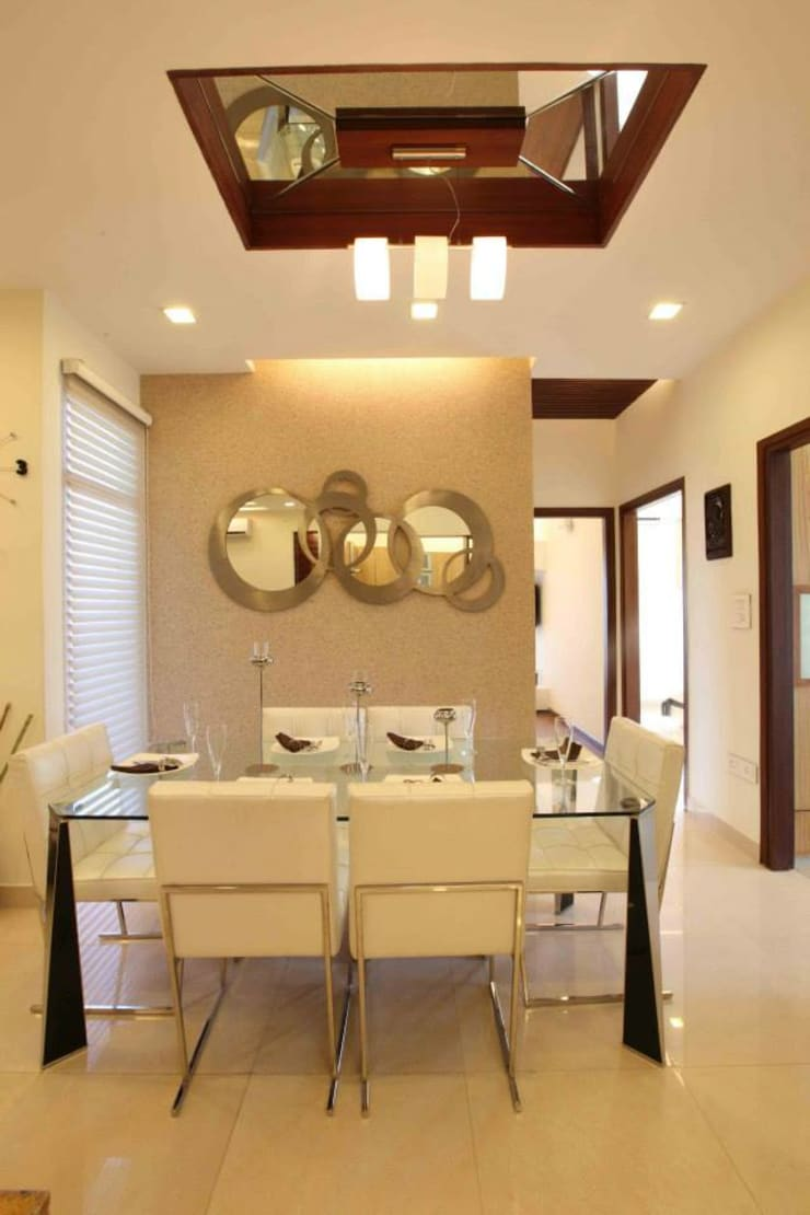SAMPLE FLAT:  Dining room by Spaces Architects@ka