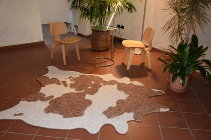 Paredes y suelos de estilo tropical de La Tenaglia Impazzita