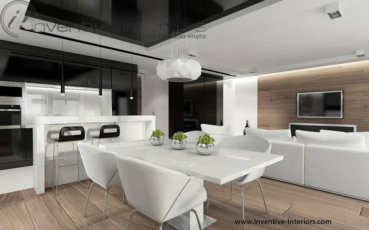 Biały stół, białe krzesła i czarny sufit w jadalni: styl , w kategorii Jadalnia zaprojektowany przez Inventive Interiors,Nowoczesny