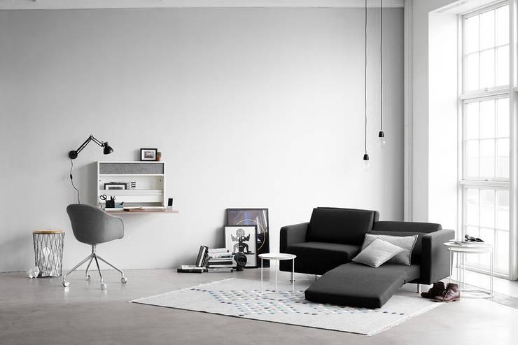 Melo 2 ソファ リクライニング/ベッド機能付: 株式会社ボーコンセプト・ジャパンが手掛けたリビングルームです。