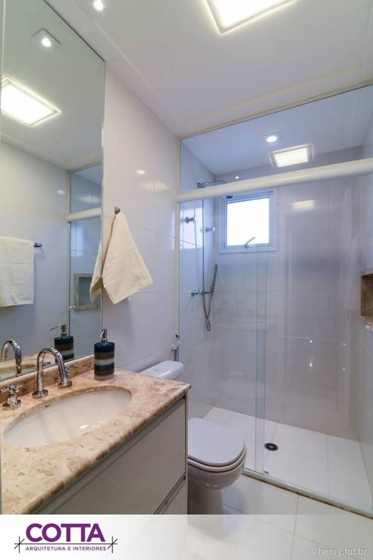 Apartamento 184m²: Banheiros  por Cotta Arquitetura e Interiores