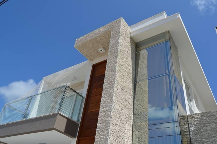 Casa KV: Casas  por Renata Matos Arquitetura & Business