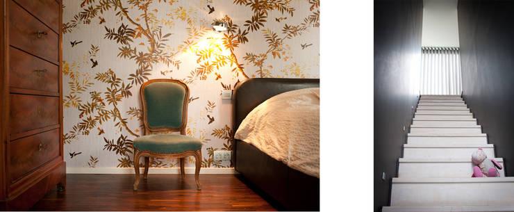 Maison Mv2: Chambre de style  par RIVA Architectes