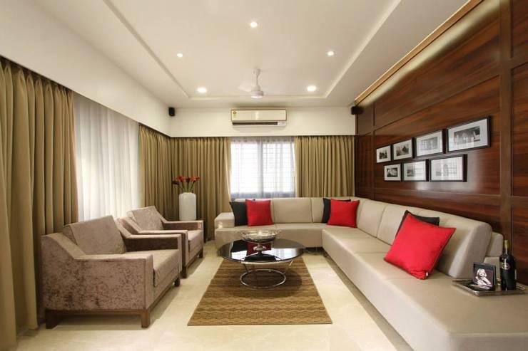 Sandeep Gandhi Bungalow:  Living room by P & D Associates