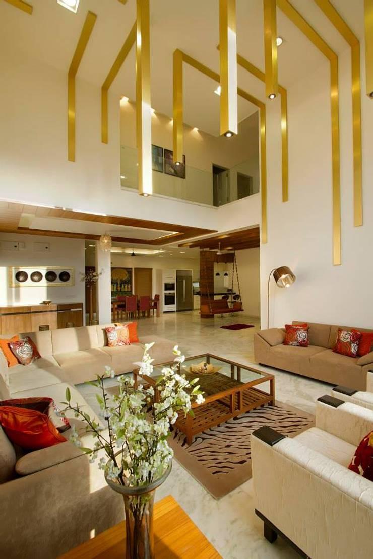 Mr.Rajan's Bungalow: modern Living room by P & D Associates