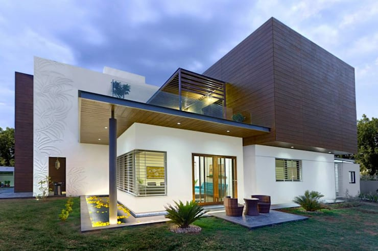 Mr.nailesh shah bungalow: modern Houses by P & D Associates