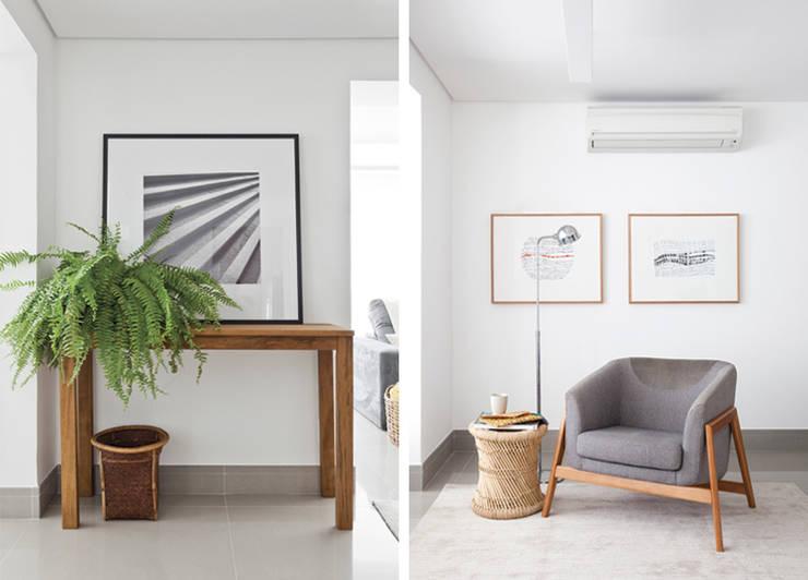 Entrada e Sala de Leitura: Salas de estar modernas por INÁ Arquitetura