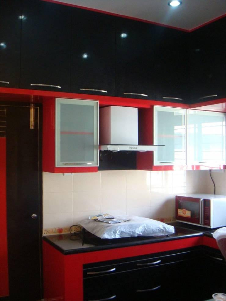 Residence in Jayanagar: modern Kitchen by Design Cafe