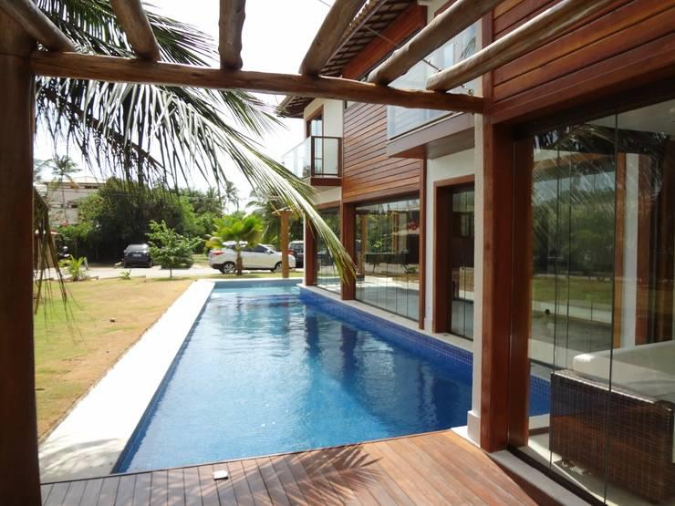 Casas de estilo  por Tupinanquim Arquitetura Brasilis