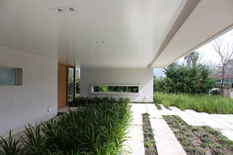Casa Moderna: Jardines de estilo  por GG&A,