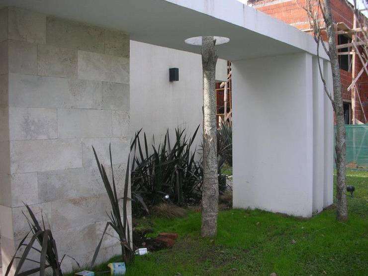 Obra en Saint Thomas: Casas de estilo  por lapassetarquitectos