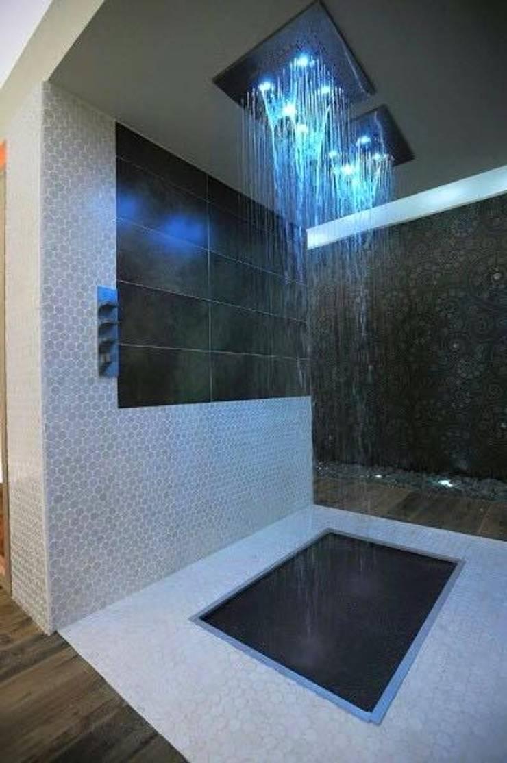 Proyectos de interiorismo varios : Baños de estilo  por estudio 60/75