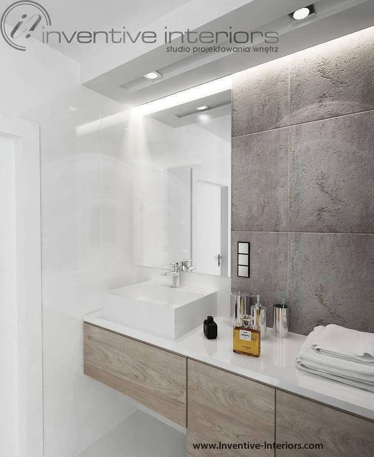 Płytki imitujące beton: styl , w kategorii Łazienka zaprojektowany przez Inventive Interiors
