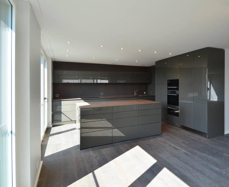 modern Kitchen by Fröhlich Architektur AG