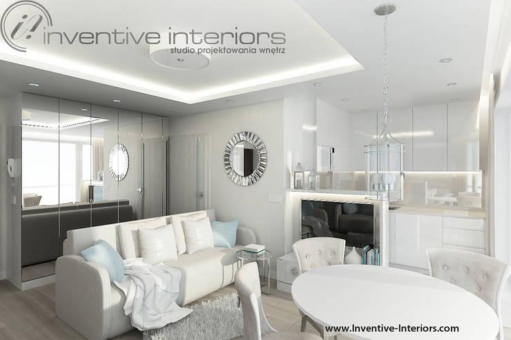 INVENTIVE INTERIORS- Projekt apartamentu nad morzem 30m2: styl , w kategorii Salon zaprojektowany przez Inventive Interiors