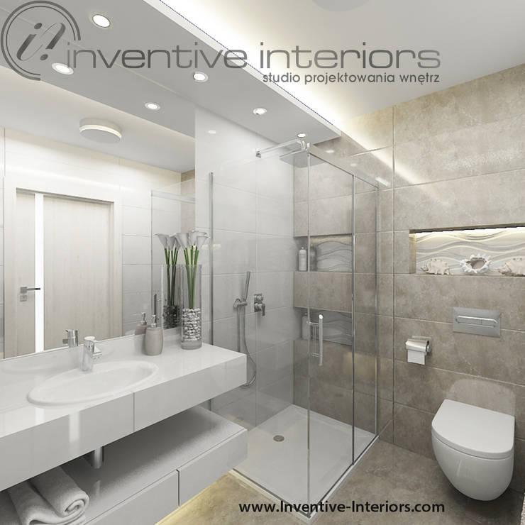 INVENTIVE INTERIORS- Projekt apartamentu nad morzem 30m2: styl , w kategorii Łazienka zaprojektowany przez Inventive Interiors