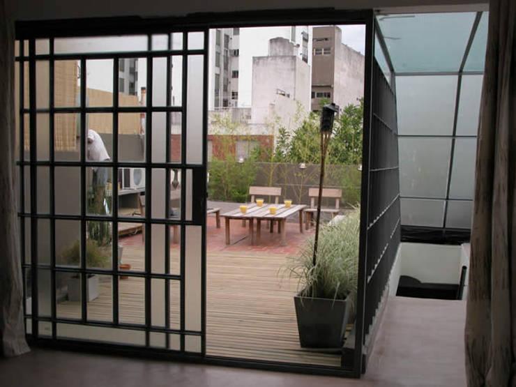 Teras oleh DX ARQ - DisegnoX Arquitectos, Modern