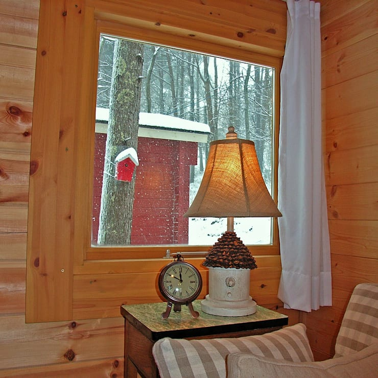 ソファからの景色: Cottage Style / コテージスタイルが手掛けたです。