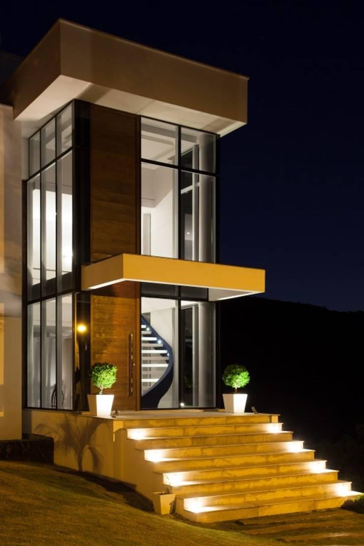 Residência Itajaí/SC : Casas  por LimaRamos & Arquitetos Associados