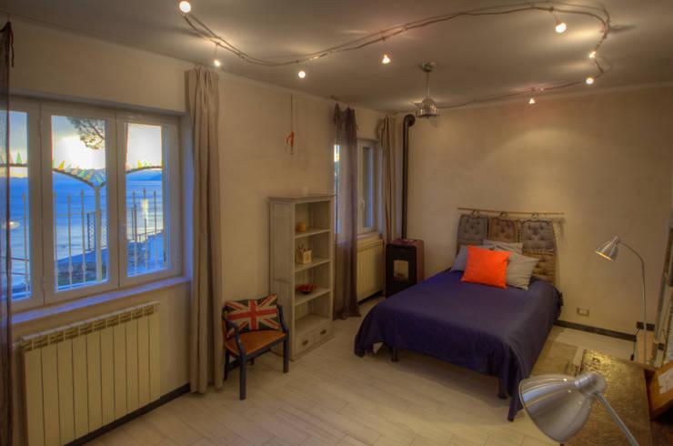 Dormitorios de estilo  por Emilio Rescigno - Fotografia Immobiliare