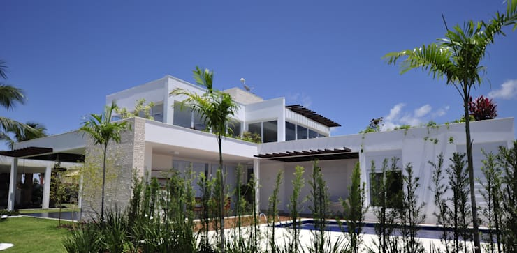 Fachada Lateral: Casas  por Libório Gândara Ateliê de Arquitetura,