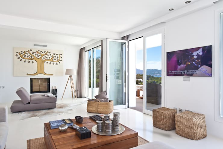 Living room by ANTONIO HUERTA ARQUITECTOS