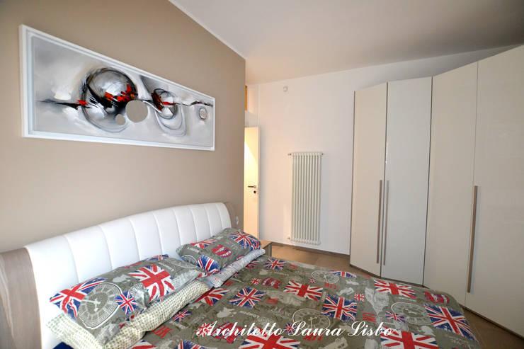 غرفة نوم تنفيذ ARCHITETTO LAURA LISBO
