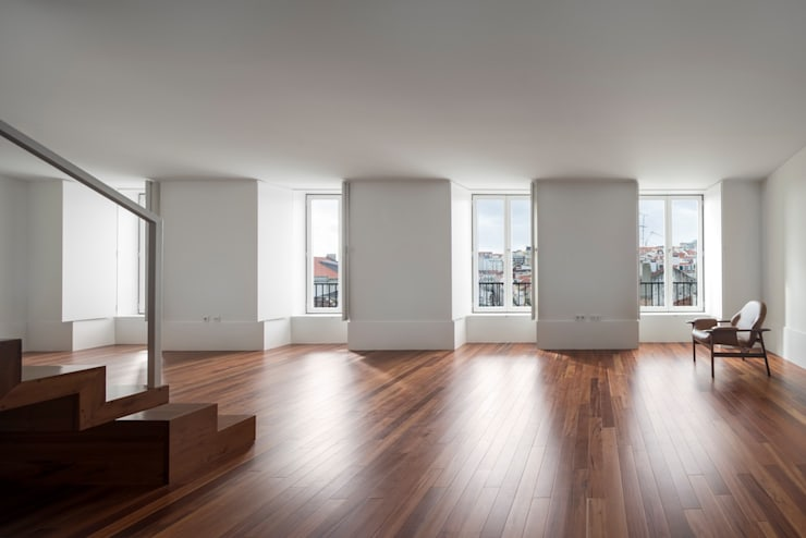 Edifício Chinesas Milagrosas - Vista da sala: Salas de estar  por Posto9 Arquitectos