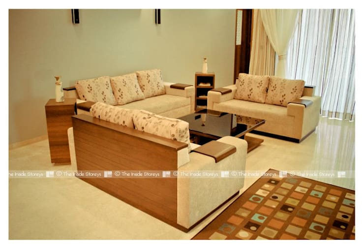 Sofa and Cusions:  Living room by The Inside Storeys