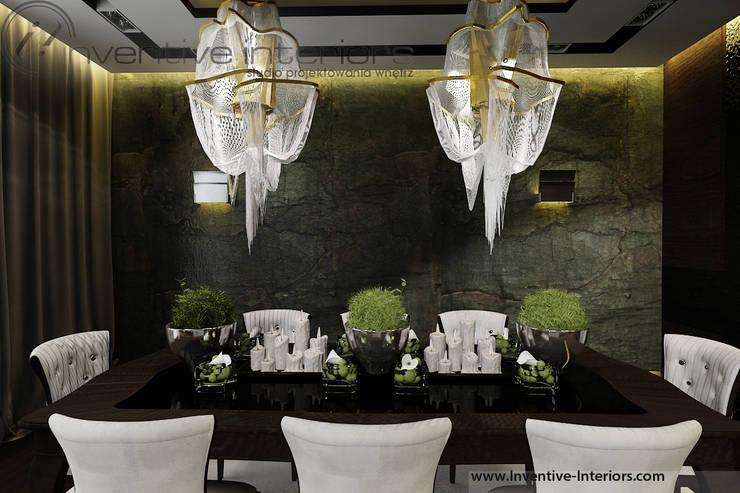 Kamień na ścianie w jadalni: styl , w kategorii Jadalnia zaprojektowany przez Inventive Interiors