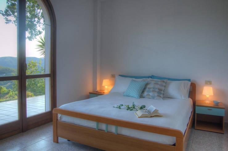 Bedroom by Emilio Rescigno - Fotografia Immobiliare