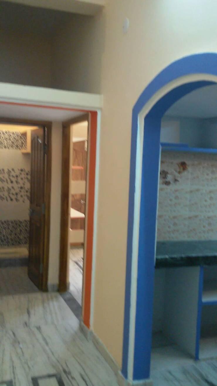 simroz palace:  Corridor & hallway by MADINA ASSOCIATES