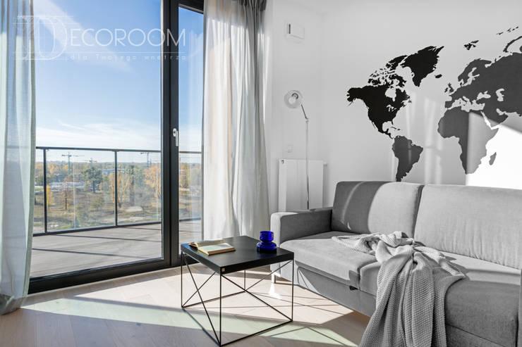 nowocześnie w bieli, szarościach i czerni.: styl , w kategorii Salon zaprojektowany przez Decoroom