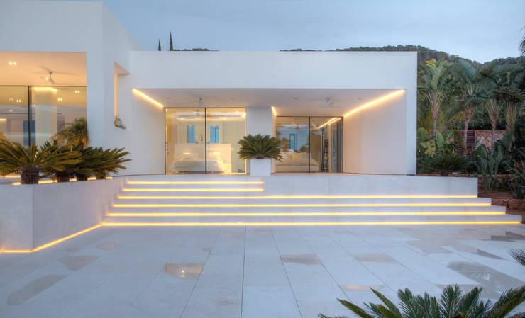 Casas de estilo  por MG&AG.ARQUITECTOS