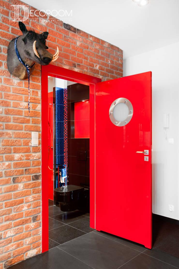 męskie mieszkanie: styl , w kategorii Korytarz, przedpokój zaprojektowany przez Decoroom,Nowoczesny