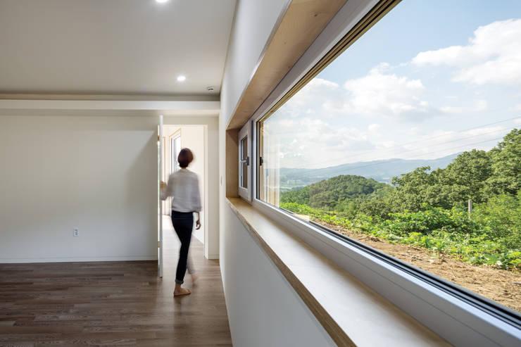 안방: B.U.S Architecture의  침실