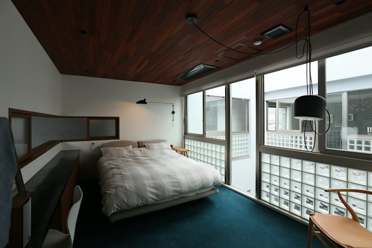 Dormitorios de estilo escandinavo de 株式会社CAPD