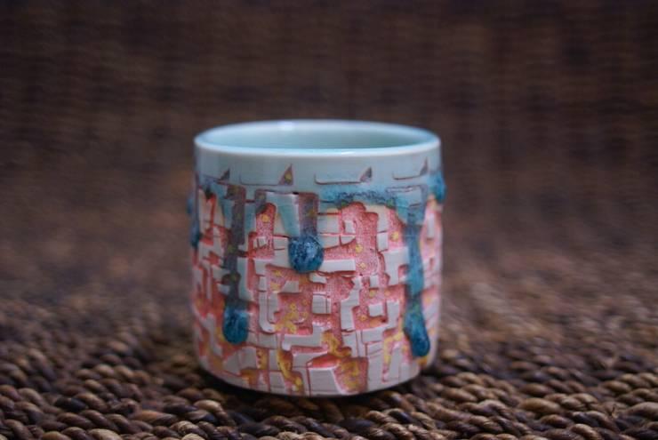 ブロック カップ: 佐藤恵一が手掛けた家庭用品です。