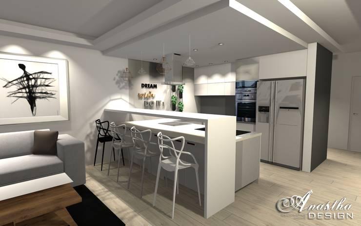Kuchnia połączona z salonem w nowoczesnym wydaniu: styl , w kategorii  zaprojektowany przez Anastha DESIGN