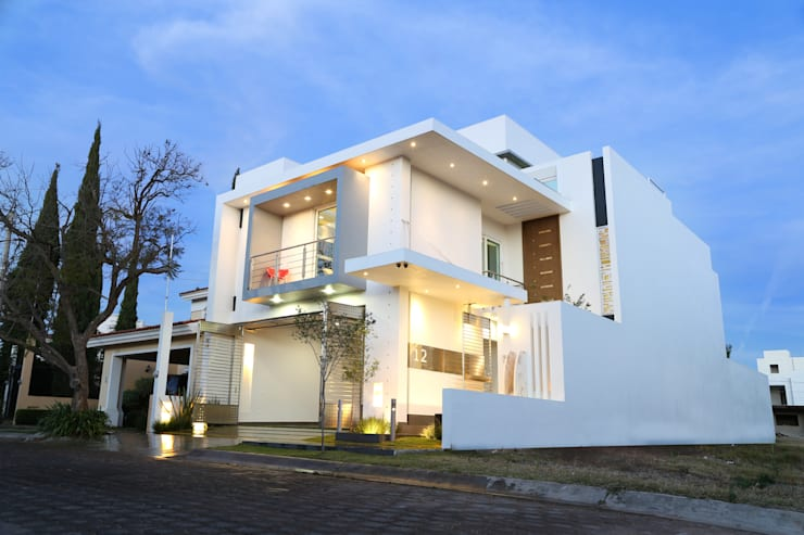 frontal: Casas de estilo moderno por arketipo-taller de arquitectura