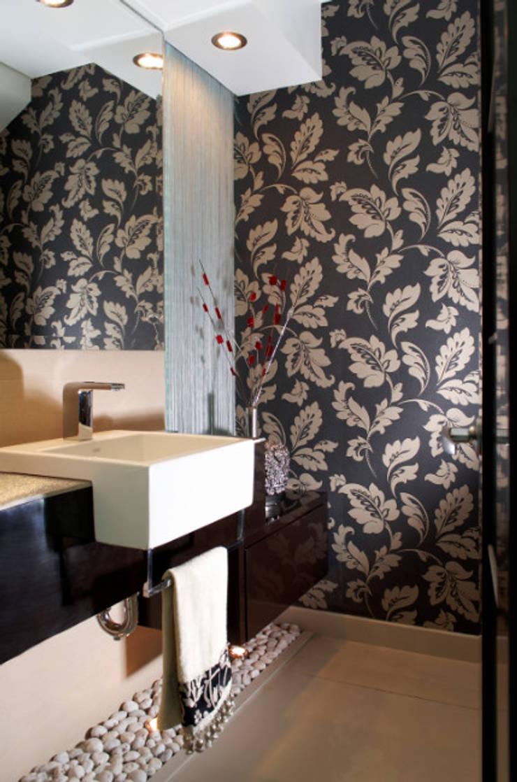 medio baño: Baños de estilo  por arketipo-taller de arquitectura