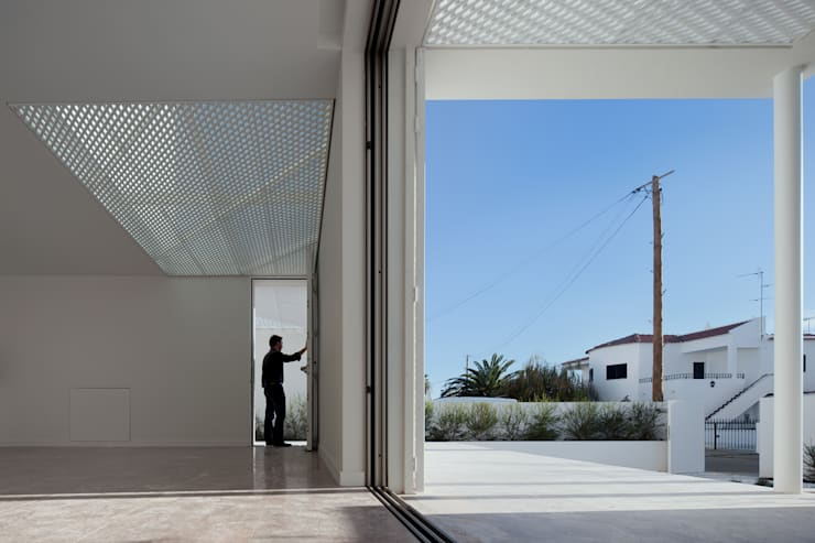 Moradias Manta Rota: Salas de estar  por Posto9 Arquitectos