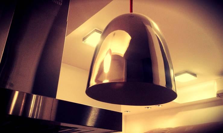 COLGANTES: Cocinas de estilo  por ARQ DANIEL CARRIZO