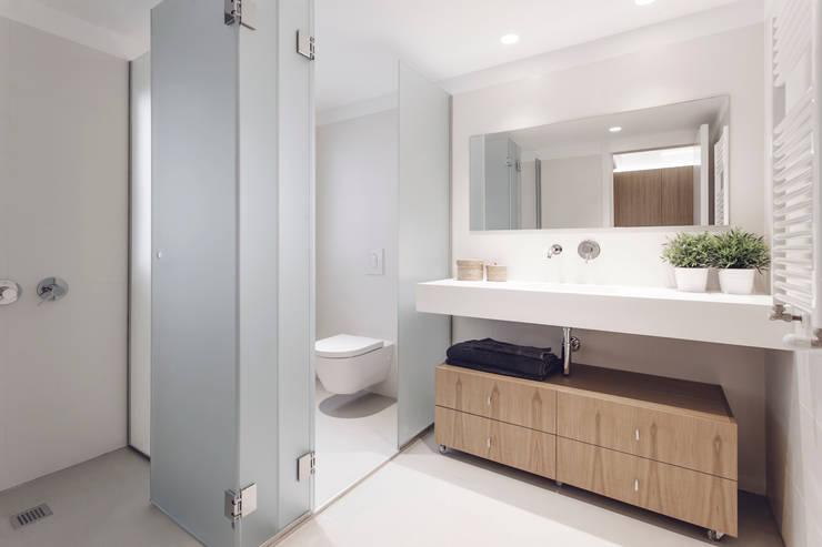 Baños de estilo  por onside