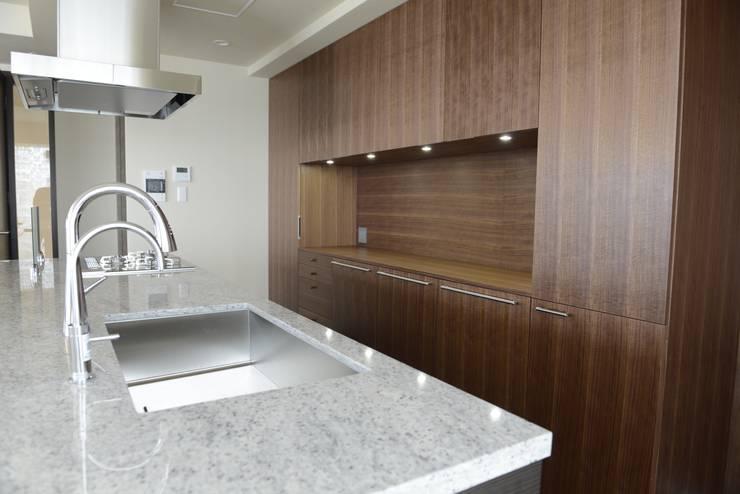 T邸: 暮らすひと暮らすところが手掛けたキッチンです。,