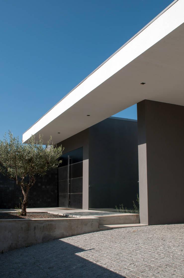 Fachada: Casas  por Miguel Zarcos Palma