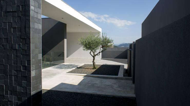 Casa Miradouro: Casas  por Miguel Zarcos Palma